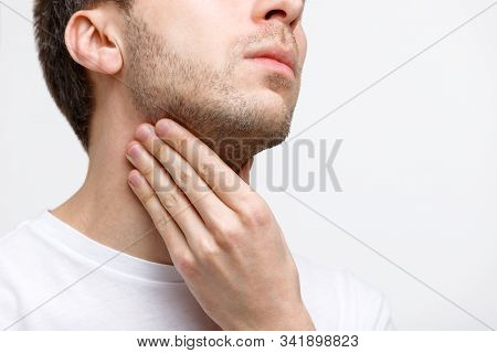 Close Up Of Sick Man Suffering From Throat Problems, Grey Background, Isolated. Lymph Glands, Painfu
