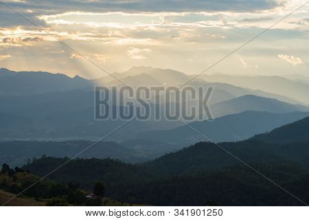 Sunlight Ray Shining On Beautiful Rice Terraces During Sunset In Pa Bong Piang Village In Chiangmai,