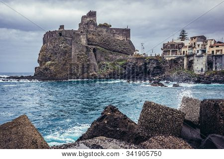 Ruins Of Norman Castle In Aci Castello Town, Sicily In Italy