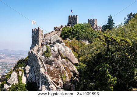 Sintra, Portugal - 21 August 2019: Tourists On The Walls Of The Moorish Fortress Above The Portugues