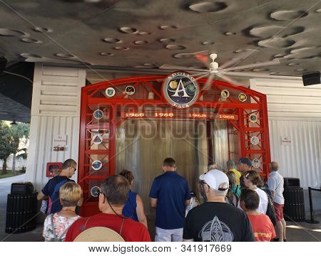 Merritt Island, Florida-october 31, 2019: Visitors Wait To View Apollo/saturn V Center Exhibits Rela