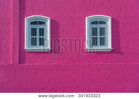 Nice White Windows On Pink Concrete Wall With Shadow