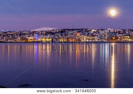 Sunrise With Amazing Magenta Color And Moon Over Tromso, Norway. Winter. Polar Night. Long Shutter S