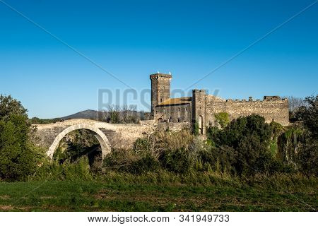 Vulci, Italy - December 26, 2019: Panoramic View From The Countryside Of The Badia Bridge And Castle