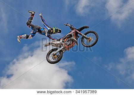 Voltana Di Lugo, Ra, Italy - April 10, 2016: Freestyle Motocross, A Stunt Biker Make A Jump And Perf