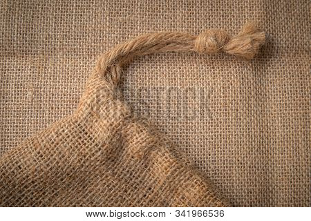 Background, Sackcloth, On The Sack Floor Covered With Beige Scales And Different Eyebrows, Sackcloth