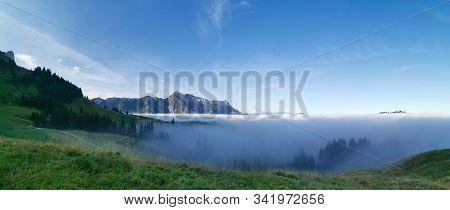Mountain Peaks Looking Out Of Sea Of Fog In Unesco Biosphere Of Entlebuch, Switzerland