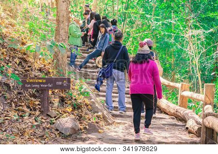 Lamphun Thailand - December 9 :  Unidentified Tourists Taking Pictures And Selfies While Hiking To K