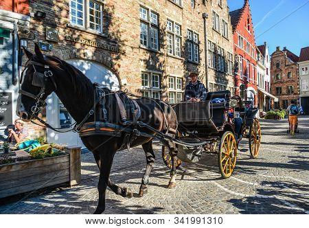 Bruges, Belgium - Oct 5, 2018. Horse Cart In Bruges (brugge), Belgium. Bruges Is Distinguished By It
