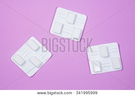 White Vaginal Antibacterial Pills On Lilac Background.candles Are Soaked In Water And Injected Into