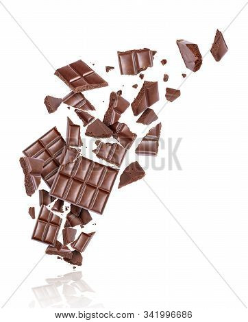 Porous Chocolate Broken Into Many Pieces In The Air, Isolated On A White Background
