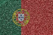 Portugal flag depicted on many small shiny sequins. Colorful festival background for party poster
