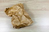 Crinkled and creased brown paper bag - copy space provided poster