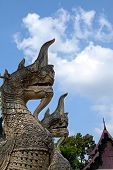 Two bird creatures sculpture looking cloud and sky at Jadee Loung temple in Chiangmai Thailand. poster
