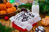 Chocolate Crinkle Cookies in powdered sugar in red metal box on a dark wooden background. Festive dessert for Christmas and New Year. Horizontal orientation. poster
