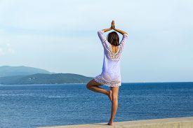 Girl Doing Yoga On Tropical Beach. Yoga On The Beach. Yoga Lifestyle. Healthy Lifestyle. Girl Doing