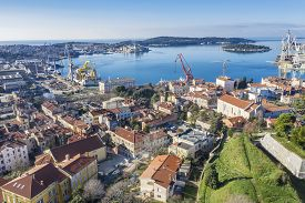 Pula, Croatia - December 25, 2019: An Aerial Shot Of Pula, View Of The Industrial Part And The Forme