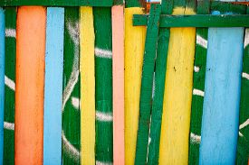 Wooden Fence With Pattern Painted White. Blue Colored Planks
