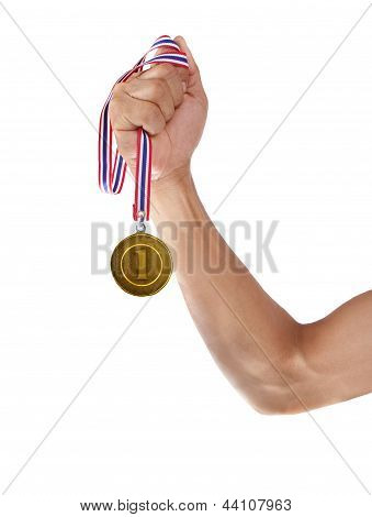 Hand And Gold Medal Isolated On White