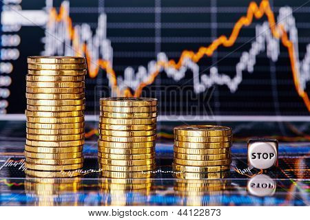 Downtrend Financial Chart, Stacks Of Golden Coins And Dices Cube With The Word Stop. Selective Focus