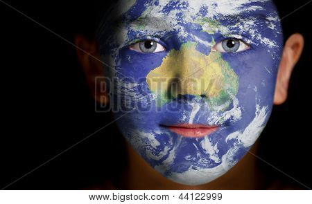 Portrait of a child with a painted Australia.