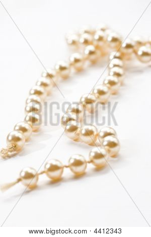 White beads on a white background Venetian pearl poster