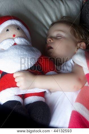 A Child Sleeping With Santa