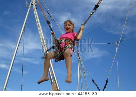 Girl Bungee Jumping On A Trampoline
