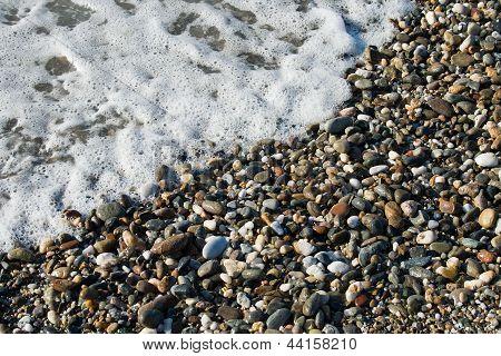 Close Up Sea Wave And Pebble
