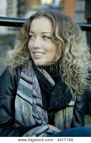 portrait of young smiling curl blond girl
