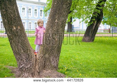 Cute Little Girl Climbing On A Tree