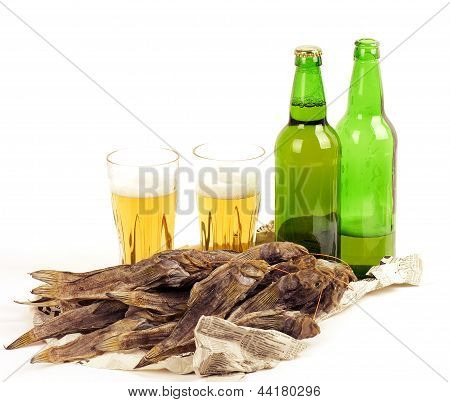 Big glass of light beer and fish.isolated