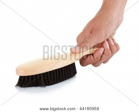 Hand With Wooden Comb