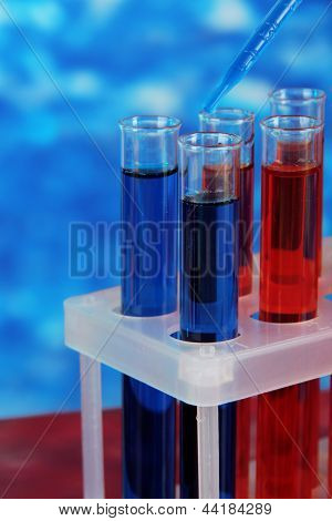 Blue and red test tubes close-up