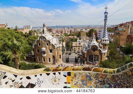 BARCELONA - SEPTEMBER 3: Park Guell entrance pavilions in sunny day on September 3, 2012 in Barcelona, Spain. Park Guell was designed by famous architect Antoni Gaudi and built in 1900-1914.
