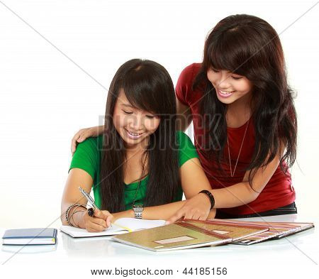 Two Young Asian Student Studying