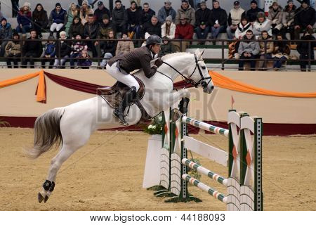 KAPOSVAR, HUNGARY - MARCH 24: Balazs Sandor jumps with his horse (Calossa Hatchee) on the Masters Tournament International Jumping Competition, March 24, 2013 in Kaposvar, Hungary
