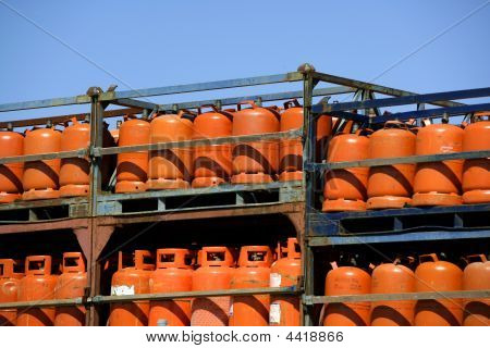 Botellas bombonas de gas butano color Naranja. Orange Gas Racks poster