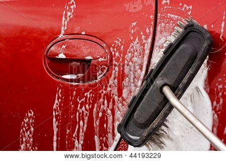 Cleaning The Car With A Brush