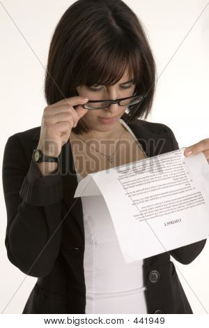 Woman Reading A Contract's Small Print