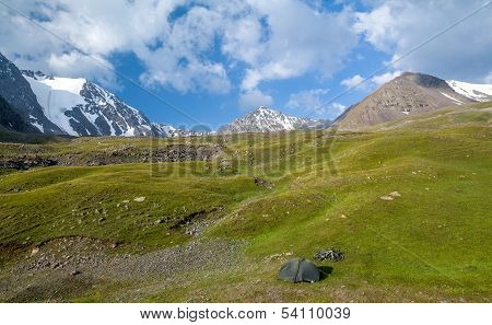 Bivouac of bicycle travellers in mountains