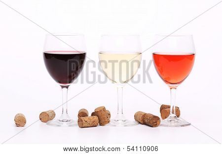 Three wine glasses and corks.