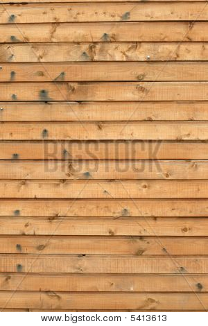 Logs of wooden house as a background poster