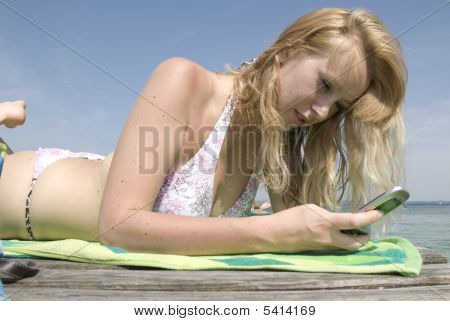 Beatiful Girl Making Call On The Beach