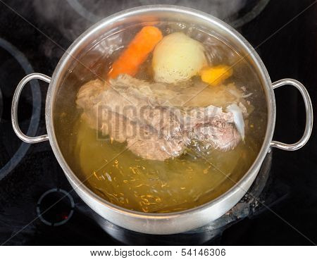 Simmer Of Beef Broth With Seasoning Vegetables