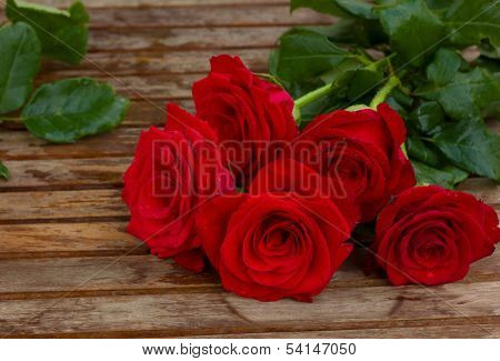 bouquet of beautiful  red roses with water drops