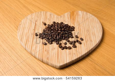 Dark Coffee Beans On Heart Shaped Chopping Board