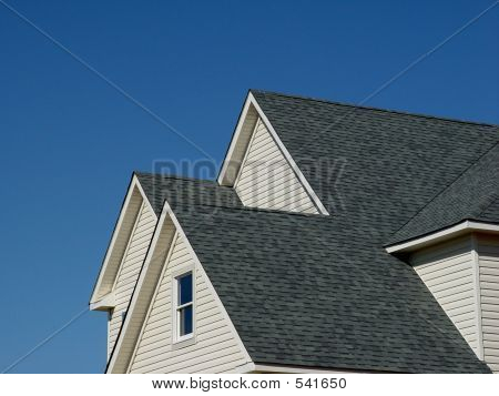House Gables and Roof over Blue Sky