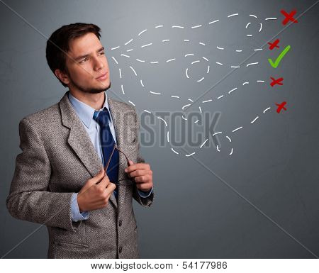 Handsome young man choosing between right and wrong sings