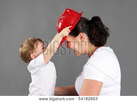 Mother And Child Playing Fireman